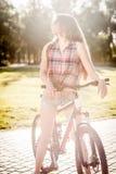 Girl sitting on bicycle Stock Photography