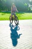 Girl sitting on bicycle Royalty Free Stock Image