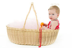 Girl sitting in a big basket Stock Photography