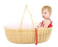 Girl sitting in a big basket Royalty Free Stock Image