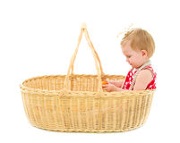 Girl sitting in a big basket Royalty Free Stock Images