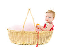 Girl sitting in a big basket Stock Images