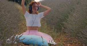Girl listening to music with headphones in summer stock video footage
