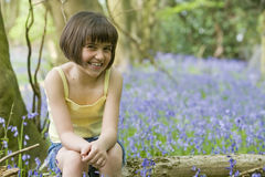 Girl sitting in bluebells Royalty Free Stock Photography