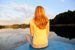 Girl sitting on boat Stock Photos
