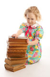 Girl sitting books stack Royalty Free Stock Image