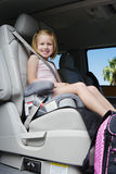 Girl Sitting In Booster Seat. Little girl riding in the booster seat Stock Photo