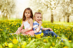 Girl sitting with boy Stock Photography