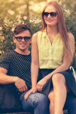 Girl sitting on boyfriends lap. Love romance flirt dating concept. Girl sitting on boyfriends lap. Young lady showing affection to her man Stock Photo