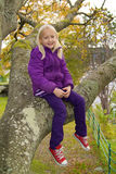 Girl sitting on a branch Royalty Free Stock Image