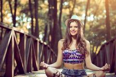 Girl sitting on bridge Royalty Free Stock Images