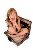 Girl sitting in briefcase. Stock Images