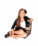 Girl sitting in briefcase. Royalty Free Stock Image