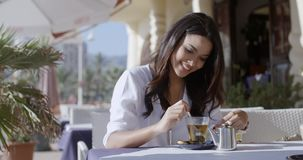 Girl Sitting At Cafe With Cup Of Tea stock video footage