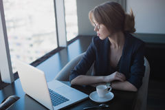 Girl sitting in cafe Stock Images