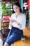 Girl sitting in a cafe Stock Photography