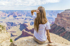 Girl sitting by canyon Royalty Free Stock Photography