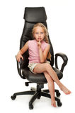 Girl sitting on a chair Royalty Free Stock Photography