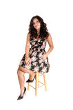 Girl sitting on chair. Stock Photos