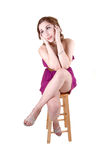 Girl sitting on chair. Stock Images