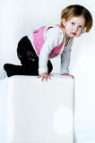 Girl sitting on a chair Royalty Free Stock Image