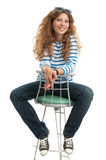 Girl sitting on chair Stock Images