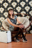 Girl sitting in a chair Royalty Free Stock Photos