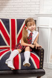 Girl sitting on chair with a British flag Stock Image