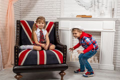 Girl sitting on chair with a British flag Royalty Free Stock Photos