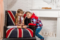 Girl sitting on chair with a British flag Stock Images