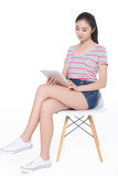 Girl sitting on a chair Royalty Free Stock Photo