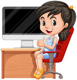Girl sitting on chair by the computer Stock Photos