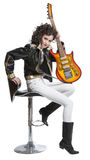 Girl sitting on the chair with electro guitar Royalty Free Stock Photos