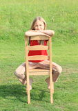 Girl sitting on chair Royalty Free Stock Photography