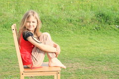 Girl sitting on chair Royalty Free Stock Photos