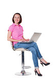 Girl sitting on chair and working Royalty Free Stock Photography