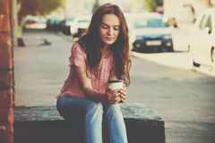 Girl sitting with coffee Royalty Free Stock Photography
