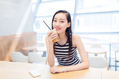 Girl sitting in a coffee shop Royalty Free Stock Image