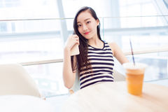 Girl sitting in a coffee shop Stock Photo
