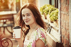 Girl sitting with coffee Stock Photo