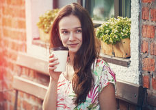 Girl sitting with coffee Stock Image