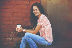Girl sitting with coffee Stock Photography