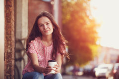 Girl sitting with coffee Royalty Free Stock Photo