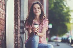 Girl sitting with coffee Stock Photos