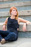 Girl sitting on concrete stairs Stock Photos