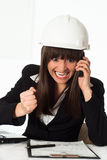Girl sitting in the construction helmet Royalty Free Stock Photo