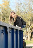Girl sitting on a container Royalty Free Stock Images