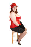 Girl sitting in corset. Royalty Free Stock Image