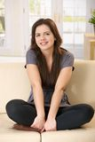 Girl sitting on couch Royalty Free Stock Photography