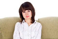 Girl sitting on the couch Stock Photo